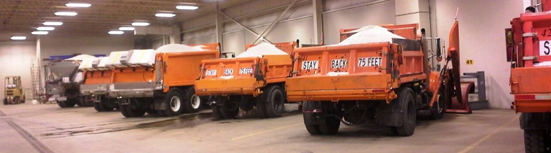 Line of Parked Snow Plows