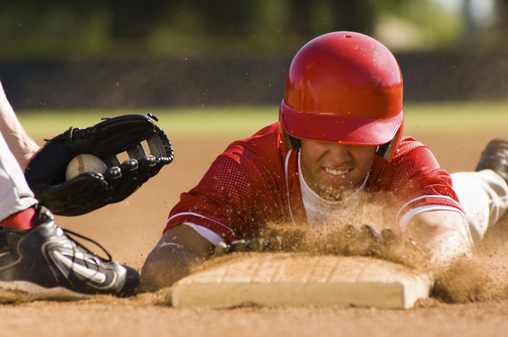 Man Sliding Head First into Base